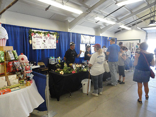 Fair attendees look at inside vendor booths